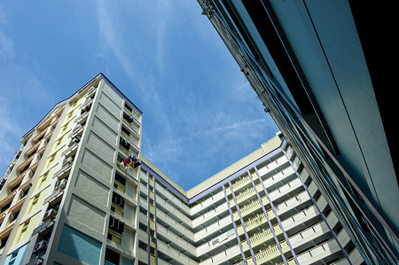 hdb: A block of HDB Flats found in Singapore against blue sky