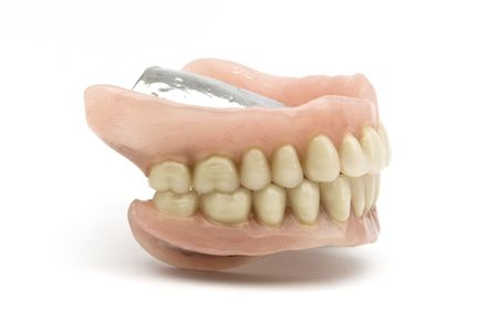 removable: Dental removable prosthesis on white background Stock Photo