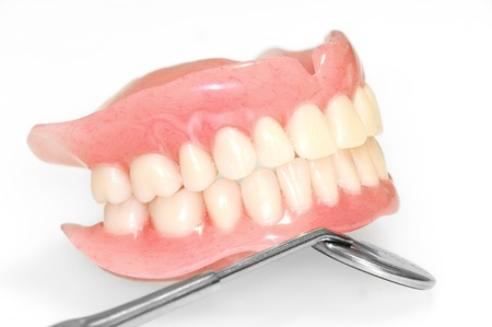 surrogate: Acrylic dentures whit mmirror on white background