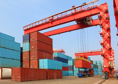 Gantry cranes at a container port Stock Photo