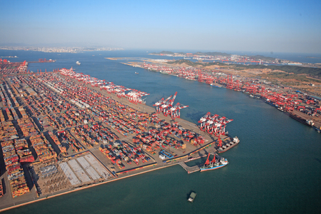 Aerial view of cranes in a container port