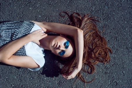 fashion girl lying on the stone floor background photo