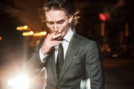 handsome man in suit walks on  night city Stock Photo - 15537892