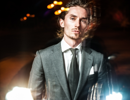 handsome man in suit walks on  night city Stock Photo - 15537753