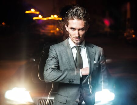 handsome man in suit walks on  night city Stock Photo - 15537789