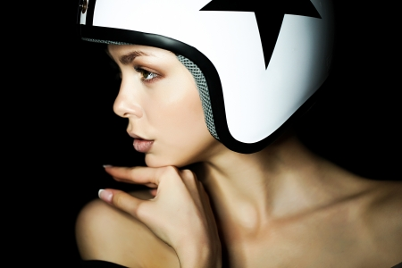 scooters: beautiful girl in helmet from scooter poses  front chamber
