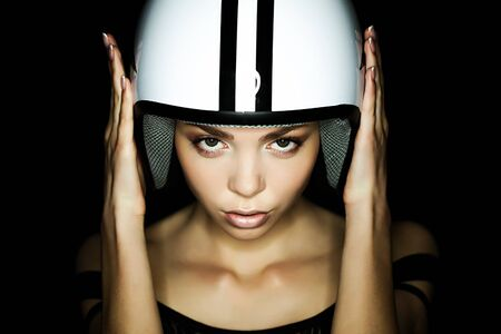 beautiful girl in helmet from scooter poses  front chamber photo