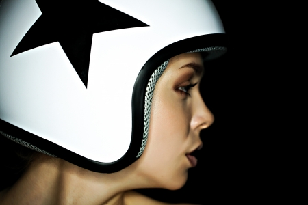 beautiful girl in helmet from scooter poses  front chamber