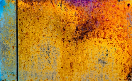 untidily: Dappled paint on wooden surface texture closeup .