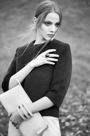 fashion bag: black and white woman fashion model outdoor portrait Stock Photo