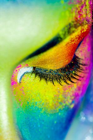 Beautiful fashion woman with color art makeup