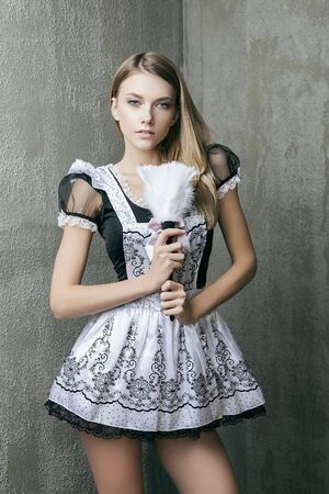 charlady: Fashion model in housemaid suit