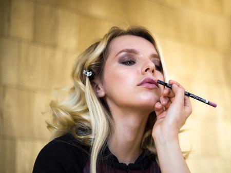 Make up artist applies cosmetics