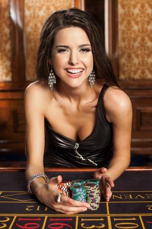 casino table: Beautiful brunette in casino
