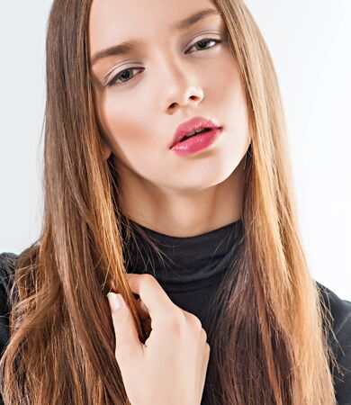 black sweater: Fashion model with long hair in black sweater