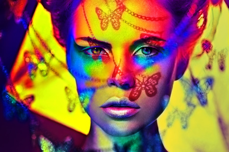 beautiful fashion woman color  face art butterfly shadow 版權商用圖片