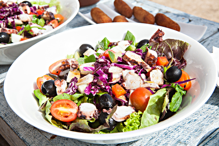 White plate of delicious vegetable salad on wooden table Stock Photo