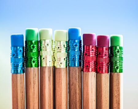 Row of color pencils on blue  background