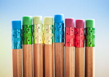 Row of color pencils on grey  background Stock Photo