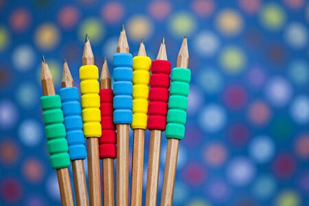 Row of color pencils on blue color  background Stock Photo