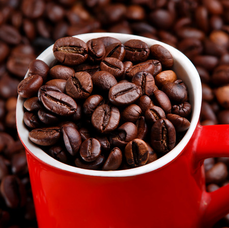 capucinno: coffee bean within red cup Stock Photo
