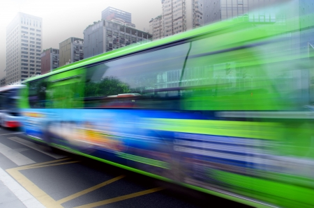 High speed and blurred bus trails on downtown road Stock Photo - 8142001