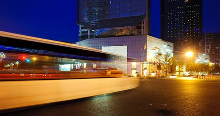High speed and blurred bus light trails in downtown nightscape Stock Photo - 8142082