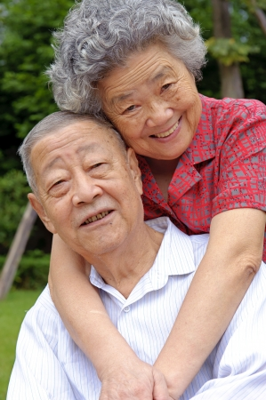an intimate senior couple embraced Stock Photo - 8142091