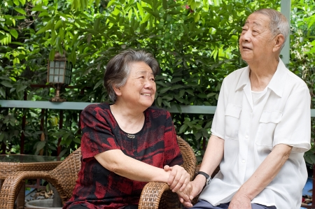 a happy senior couple look at each other lovely. photo