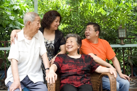 a happy senior couple and their children Stock Photo