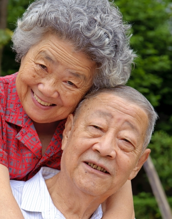 an intimate senior couple embraced Stock Photo