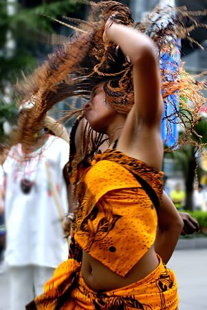 intangible: CHENGDU - MAY 23: Madagascan girl perform folk dance in the 1st International Festival of the Intangible Cultural Heritage China,2007 on May 23, 2007 in Chengdu, China.