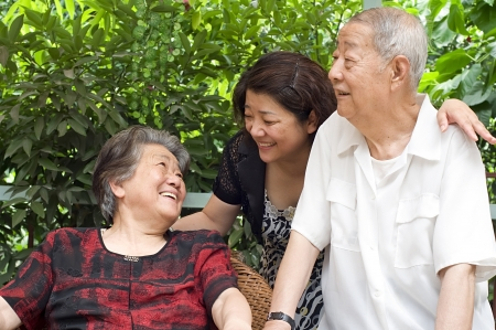 a happy senior couple and their daughter Stock Photo - 8389562