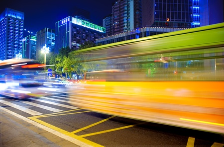 High-speed vehicles bright light trails on urban roads at night Stock Photo - 8430518