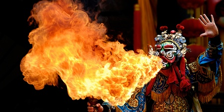 chinese opera actor perform to spout fire Stock Photo