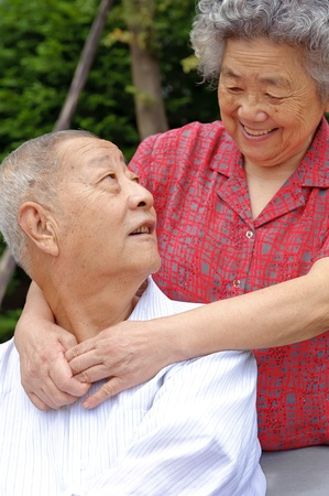 intimate: an intimate senior couple embraced Stock Photo