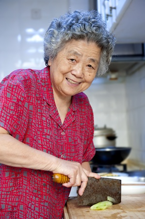 chinese woman: grandmother preparing to cook