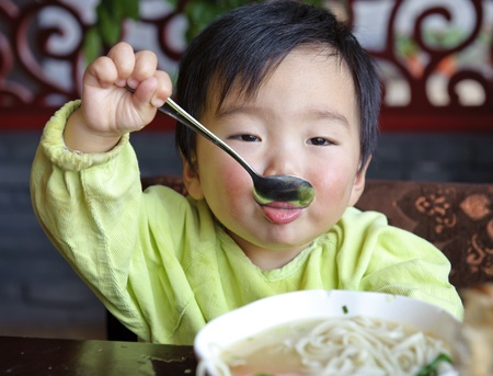 a cute baby is eating