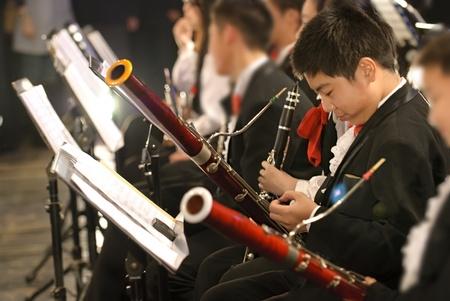 fagot: Chłopiec fagot in concert