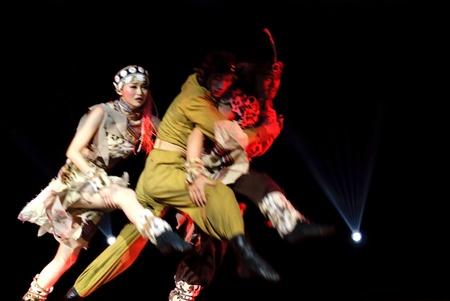 wei: CHENGDU - DEC 10: Trios dance Hump Love performed by Kunming Song and Dance Troupe at Golden theater.Dec 10,2007 in Chengdu, China. Choreographer: Yang Tao, Cast: Chen Jiajia, Ro Hee, Yang Wei