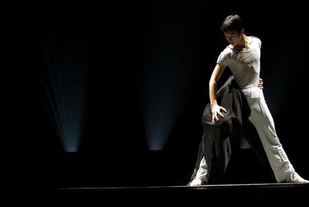 CHENGDU - DEC 11: Duo dance Me Me performed by Hunan Normal University Song And Dance Troupe at JINCHENG theater.DEC 11,2007 in Chengdu, China. Choreographer: Liu Xiaobiao, Xie Chun, Tian Xue, Cast: Li Xiaogang, Li Peiguang 新聞圖片
