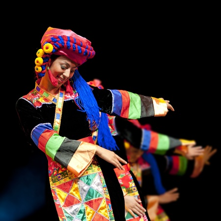 CHENGDU - SEP 28: chinese Qiang ethnic dance performed by song and dance troupe of Aba Tibetan and Qiang autonomous prefecture at experimental theater in the 6th Sichuan minority nationality culture festival.Sep 28,2010 in Chengdu, China. Editorial