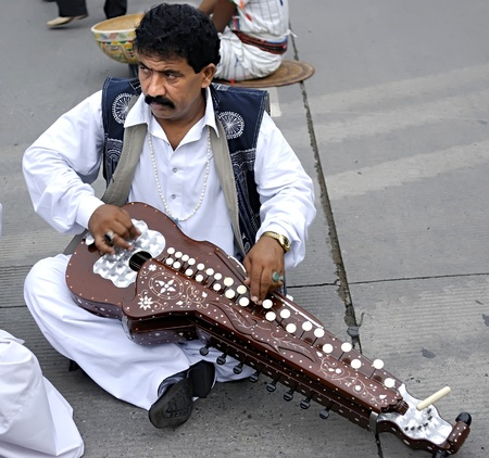 folk heritage: CHENGDU - MAY 23: Folk music show of Pakistani performer in the 1st International Festival of the Intangible Cultural Heritage China,2007 on May 23, 2007 in chengdu, china.