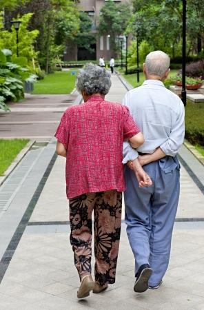 an intimate senior couple are walking Stock Photo