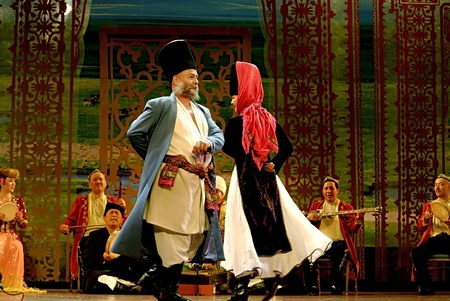 folk heritage: CHENGDU - MAY 23: The Muslim folk music show Nava Maqam performed by the Muqam Art Troupe of Xinjiang at Golden theater during the 1st International Festival of the Intangible Cultural Heritage China,2007.May 23, 2007 in Chengdu, China. The Performance  Editorial