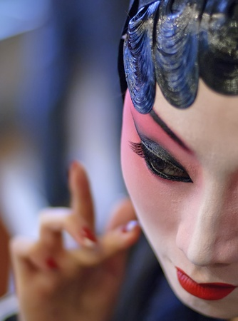 CHENGDU - Dec 15: a chinese opera actress is painting her face at backstage at JingJiang theater on Dec 15,2007 in Chengdu; China. Stock Photo - 8587728