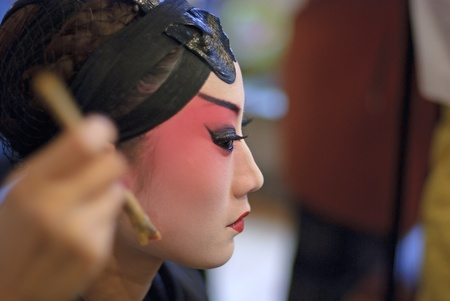 CHENGDU - Dec 15: a chinese opera actress is painting her face at backstage at JingJiang theater on Dec 15,2007 in Chengdu; China.