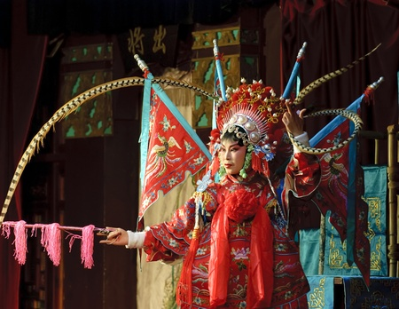 china opera actress with theatrical costume and facial painting