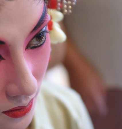 CHENGDU - Jul 26: a chinese opera actress is painting her face backstage at JinJiang theater on Jul 26,2007 in Chengdu, China. Editorial