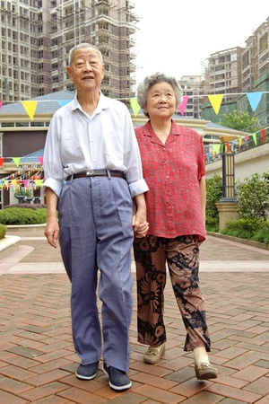an intimate senior couple are walking photo